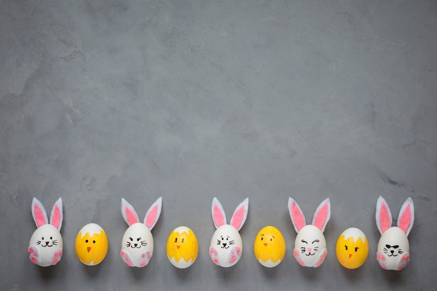 Happy easter background, bunny and chicken painted eggs, copy space