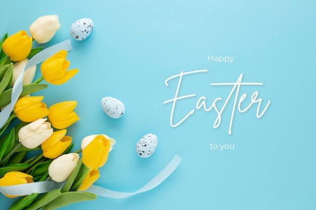 卵とチューリップとレタリングと幸せなイースターの背景