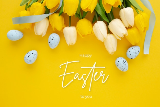 Happy easter background with eggs and tulips and lettering