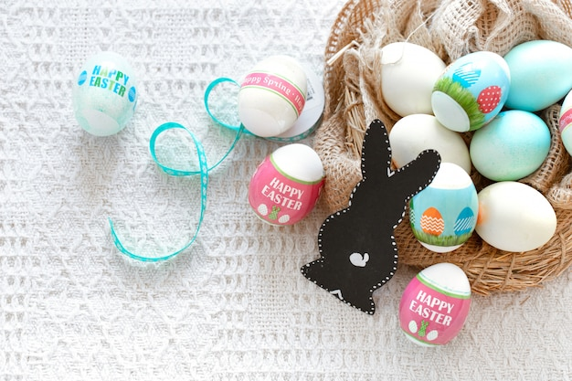 Happy easter. beautiful easter composition with colorful eggs and a paper hare.
