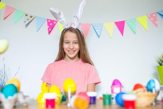Happy easter beautiful little kid wearing bunny ears on easter day