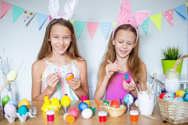 Happy easter beautiful little kids wearing bunny ears on easter day