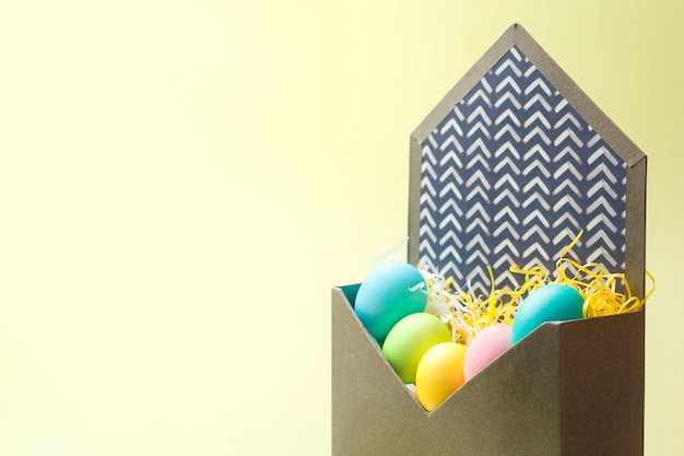 Happy easter card with easter eggs in envelope on cream colors.