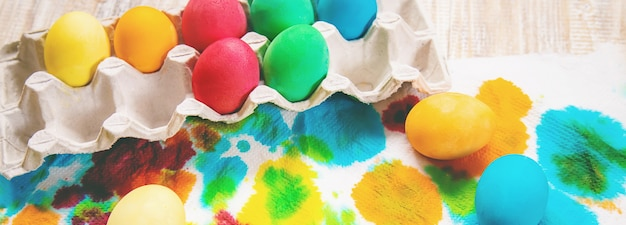 Happy easter celebration, easter eggs painted on white wood