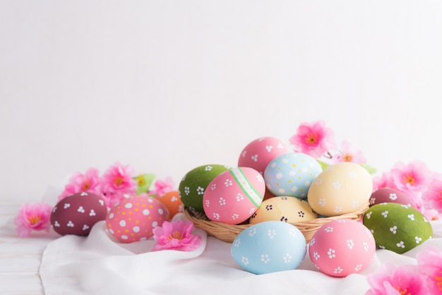Happy easter! colorful of easter eggs in nest with flower