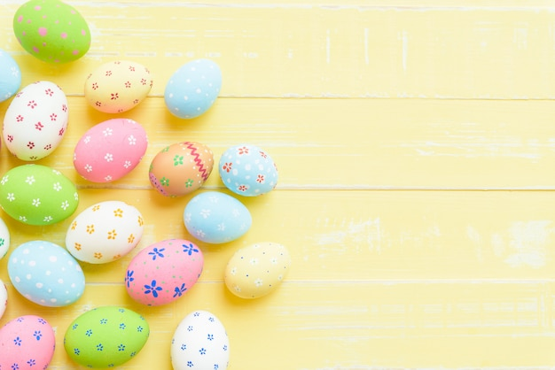 Happy easter! colorful of easter eggs on wooden background.