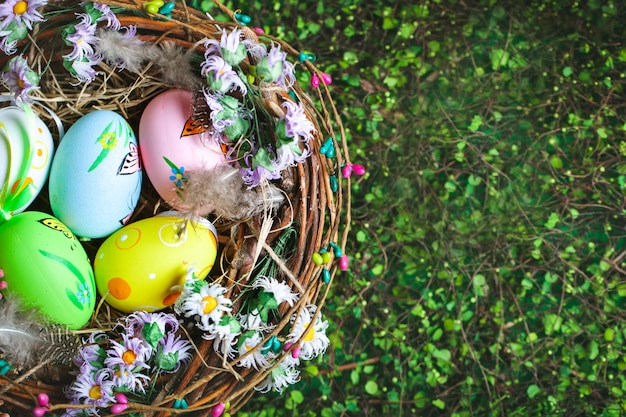 Happy easter. congratulatory easter background. easter eggs and flowers. background with copy space. selective focus. top view.