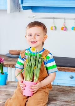 Happy easter. cute boy getting ready for the holiday. easter decoration.