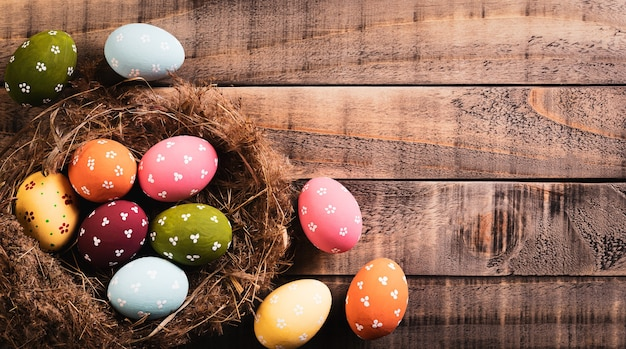 Happy easter decoration concept! beautiful easter eggs on old wooden table
