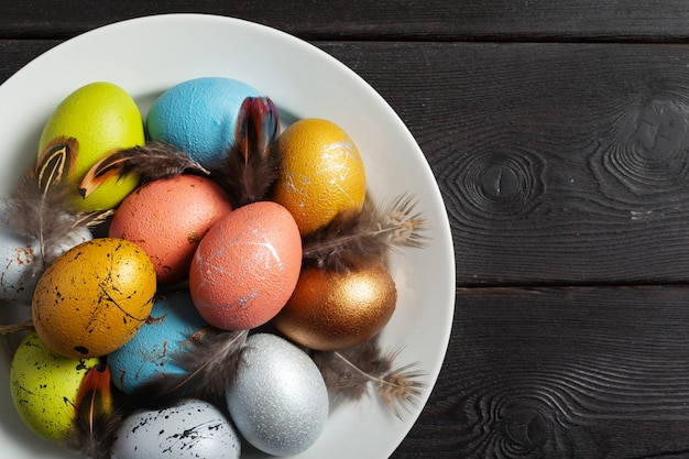 Happy easter! easter eggs on wood