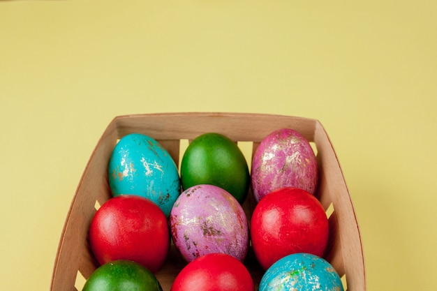 Happy easter eggs yellow background. golden shine decorated eggs in basket, for greeting card, promotion, poster. copy space