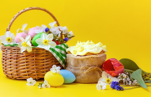 Happy easter with flowers on a yellow background. celebration.
