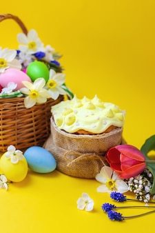 Happy easter with flowers on a yellow background.