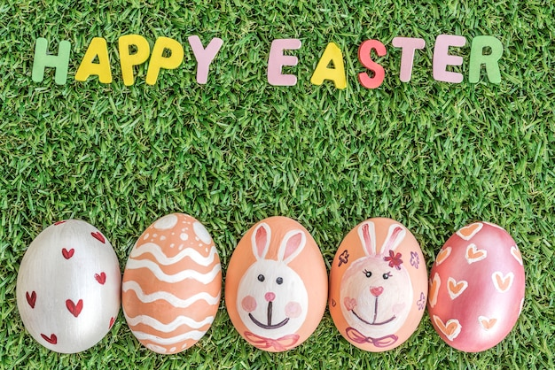 Happy easter word spelling on grass background