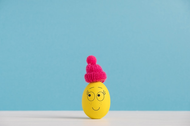 Happy egg in hat. easter holiday concept with cute eggs with funny faces. different emotions and feelings.