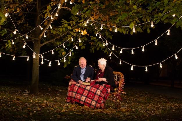 Happy elderly couple in the park, grandma and grandpa