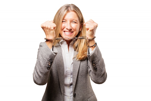 Happy elderly woman handcuffed in both hands