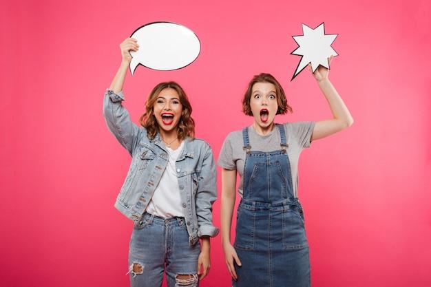 Happy emotional ladies friends holding speech bubbles.