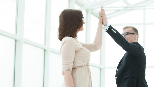 Happy employees giving each other high five. concept of success