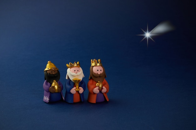 Happy epiiphany day. three wise man ant star on blue