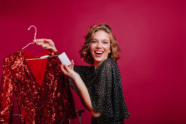 Happy european female model found cheap red sparkle dress for party