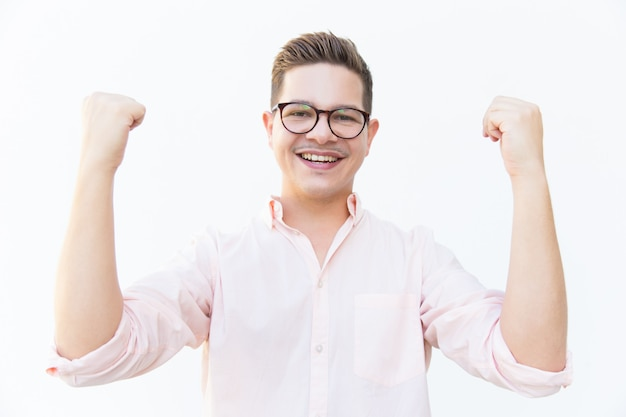 Happy excited guy in eyeglasses celebrating success