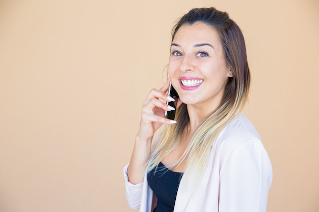 Happy excited lady enjoying phone talk