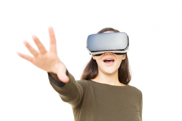 Happy excited woman in vr headset touching air and shouting