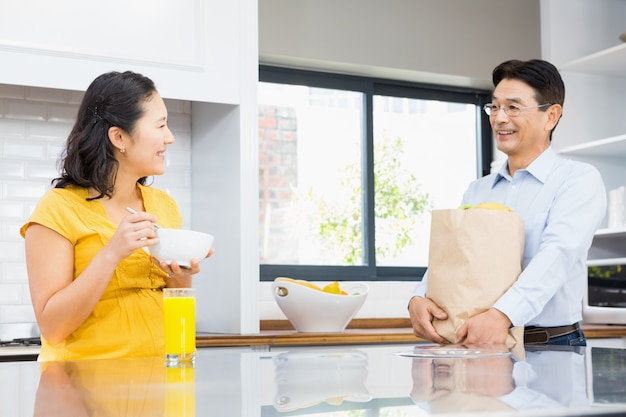 Happy expectant couple in the kitchen in the morning
