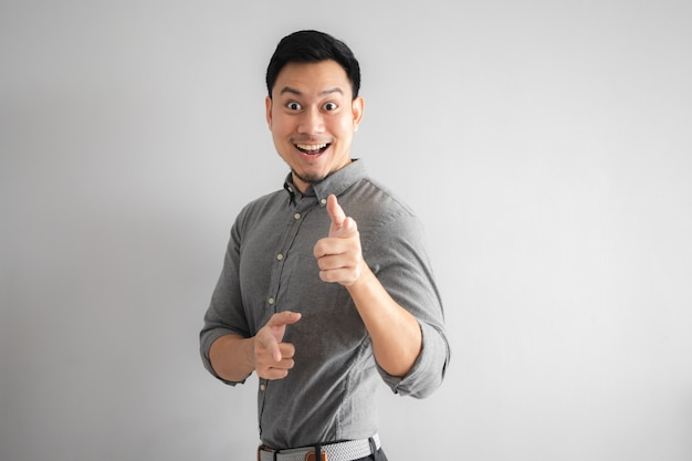 Happy face of funny good looking man with hand sign pointing.