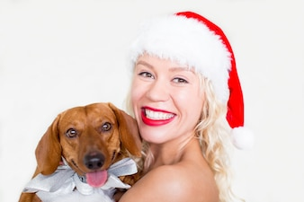Happy face of young woman with dachshund dog