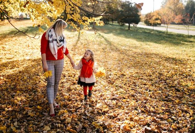Happy family on autumn walk Free Photo