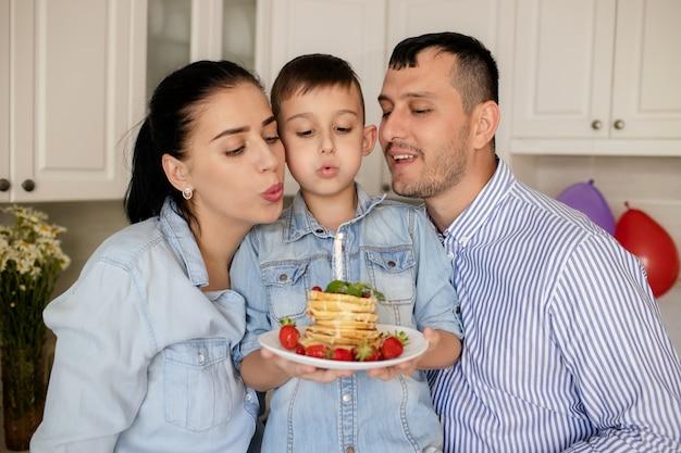 Happy family, baby's birthday at home