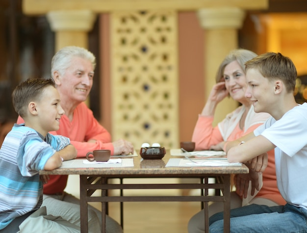 Happy family at breakfast on tropical resort
