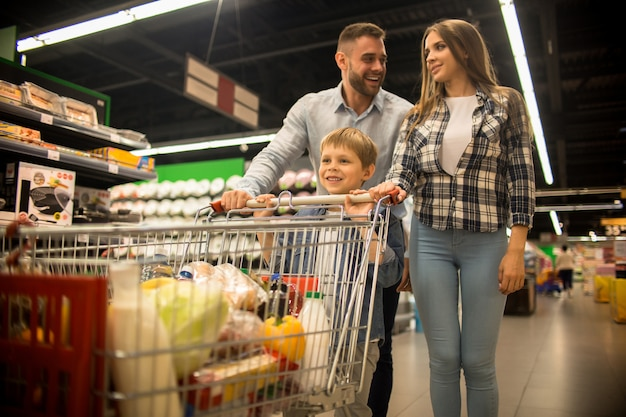 Happy family buying groceries in supermarket