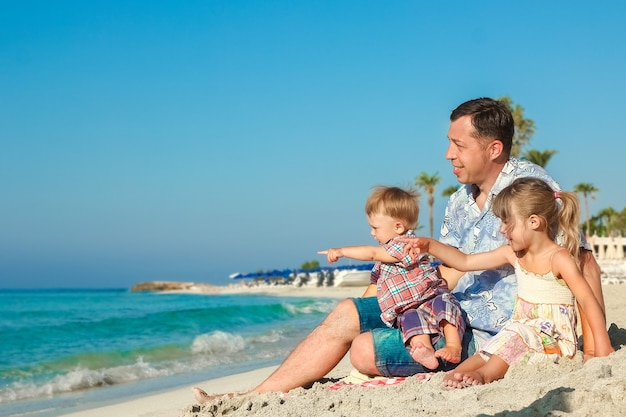 Happy family by the sea in the open air