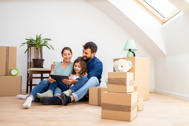 Happy family choosing house interior design on tablet computer