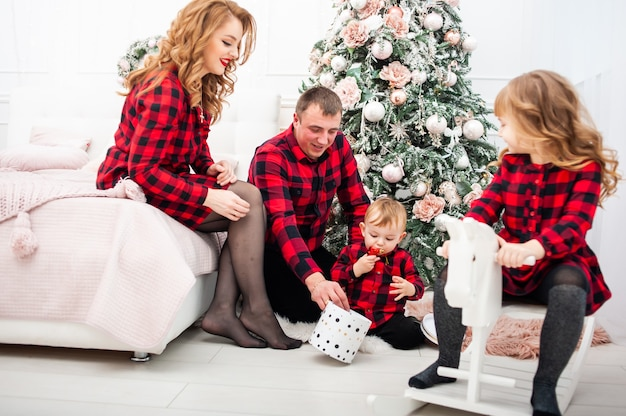Happy family on chrismas eve
