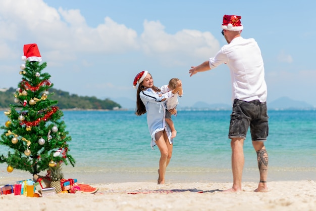 Happy family. christmas couple and childhood. sea background.