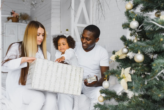 Happy family in the christmas morning