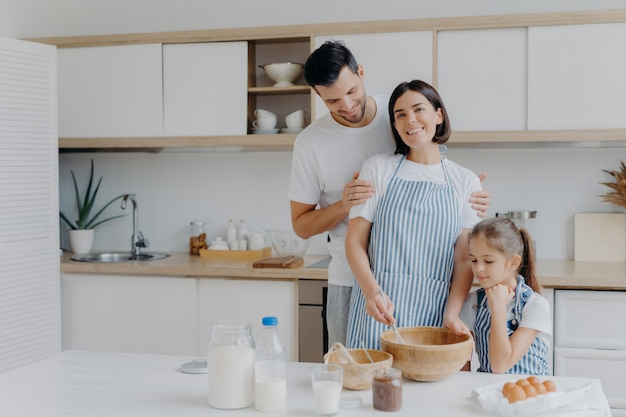 Happy family cook together at kitchen.
