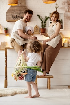 Happy family cooking in the kitchen