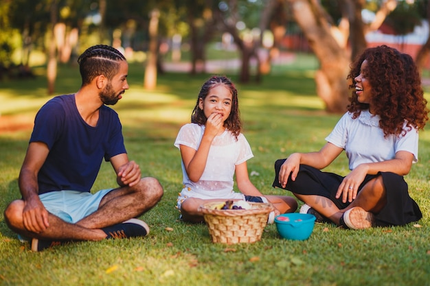 Happy family doing picnic in the park