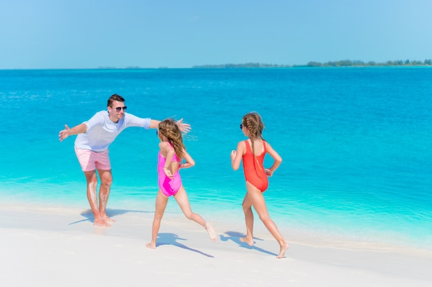Happy family enjoying beach time and have a lot of fun