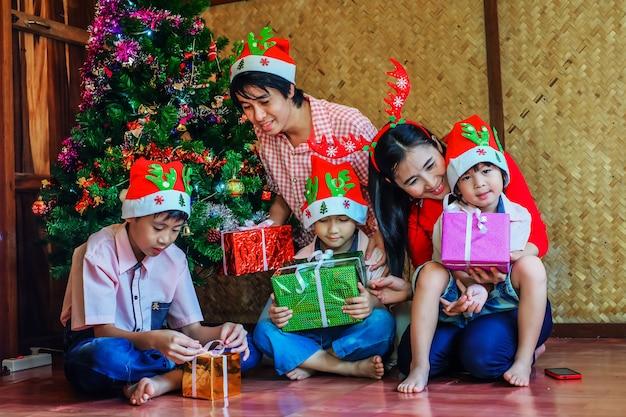 Happy family enjoying for christmas gift in christmas festival.