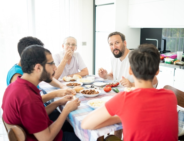 Happy family enjoying eating food in dining room