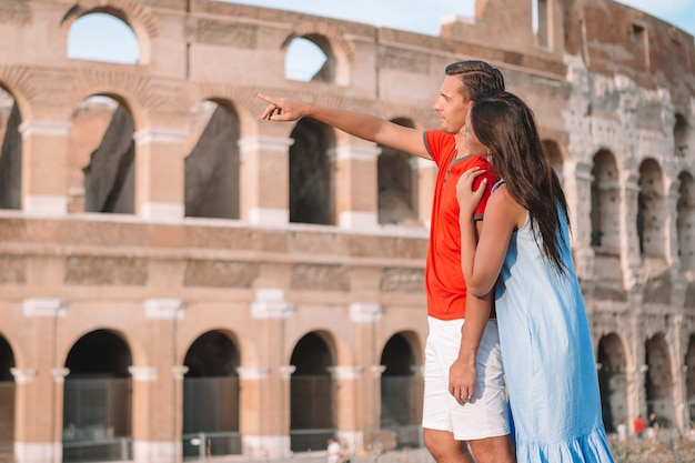 Happy family in europe. romantic couple in rome over coliseum