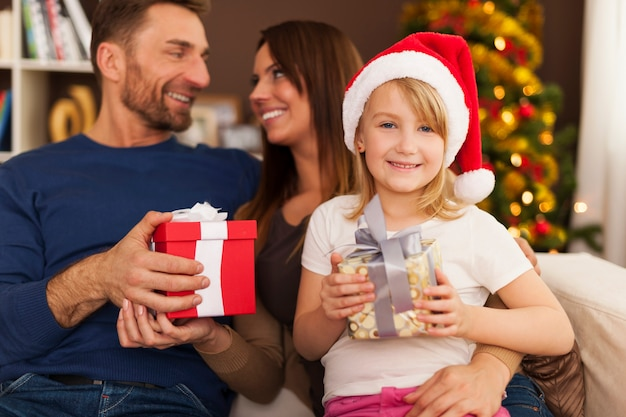 Happy family exchanging christmas gifts