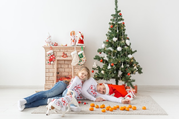 Happy family. father and child at christmas tree at home