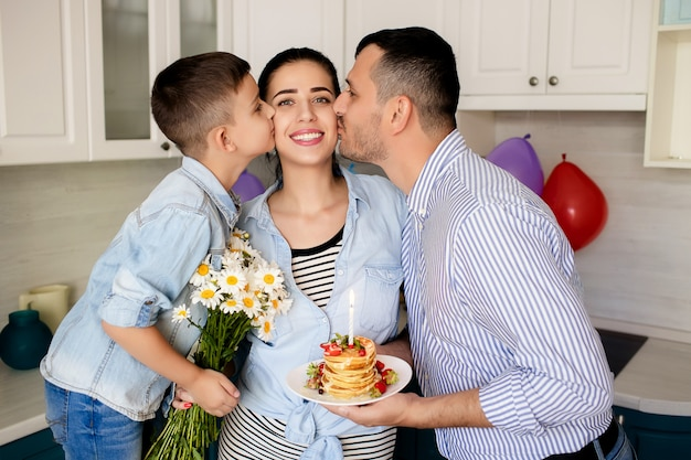 Happy family, father and son wish mom happy birthday
